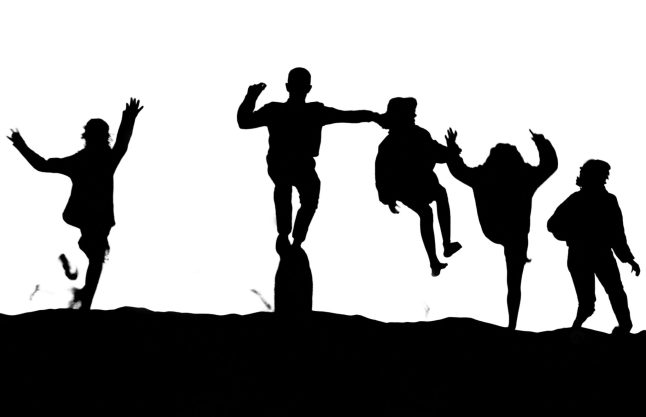 Friends Jumping Off Sand Dune, Moro Bay, CA