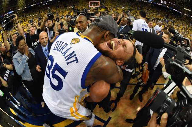 OAKLAND, CA - JUNE 12: Kevin Durant #35 and Stephen Curry #30 of the Golden State Warriors celebrate after winning the 2017 NBA Finals on June 12, 2017 at ORACLE Arena in Oakland, California. NOTE TO USER: User expressly acknowledges and agrees that, by downloading and/or using this photograph, user is consenting to the terms and conditions of Getty Images License Agreement. Mandatory Copyright Notice: Copyright 2017 NBAE (Photo by Andrew D. Bernstein/NBAE via Getty Images)