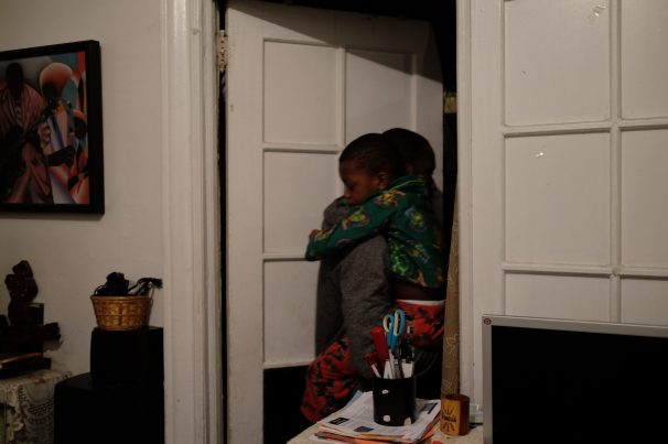 Bronx, NY Oct. 12, 2014 Travis moves his son Zaire from grandma's bed into his own. Photo by M.B. Elian
