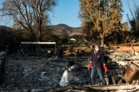 """Daphne is searching thought the debris of her family home with her daughter Claire, looking for any belongings that are in tact. The night the fires started she felt that this was more serious """"there have always been fires here and we have evacuated before, the winds where 85 miles an hour, it was a recipe for disaster - but I never assumed my home would burn down"""""""