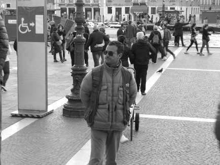 One of Venice's many hotel porters, awaiting a fare at the train station.