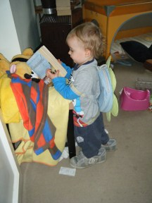 Liam decked out in my shoes and his flower backpack while reading a history of Constantinople.