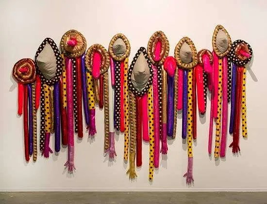 Sarah Contos, Birthday Party, 2014, various fabrics poly fil thread and found gloves, dimensions variable