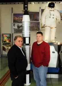 Paul Thomarios with Andrew Thomas in Thomarios's Copley office main lobby