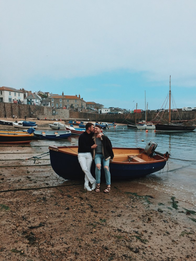 Jacob & Tommy Sitting On A Boat In Mousehole, Cornwall