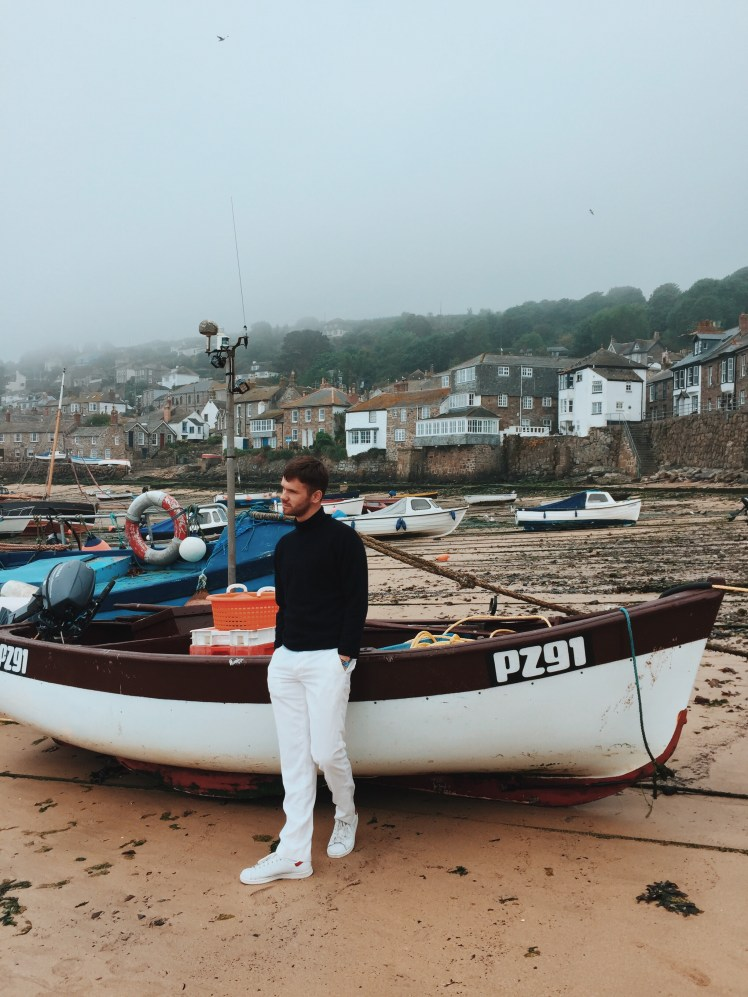 Jacob Next to Boat In Mousehole Fishing Port