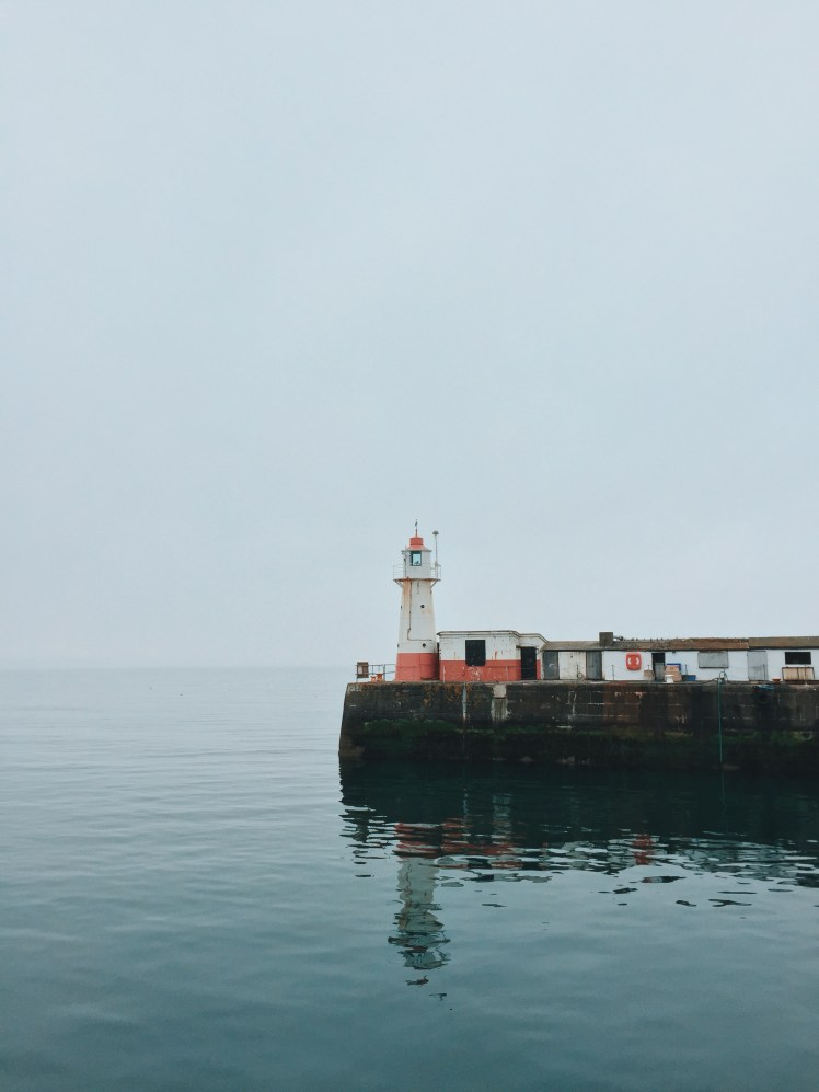Lighthouse In Harbour at Newlyn Cornwall