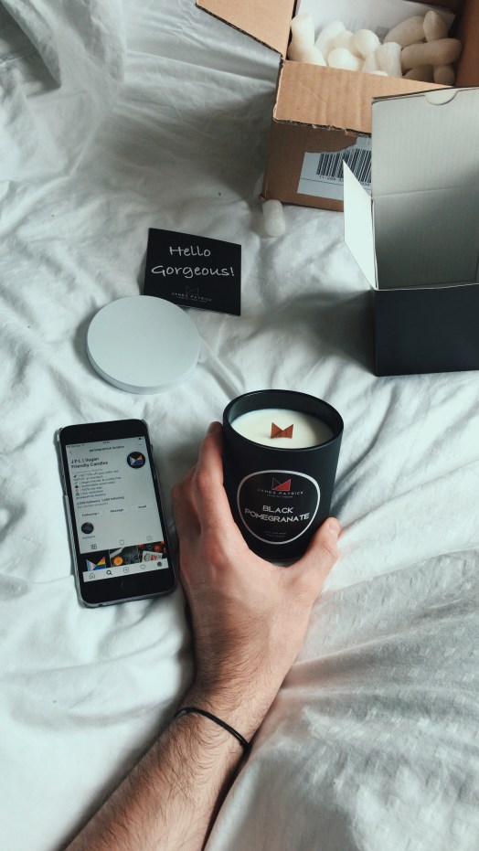 Unboxing the James Patrick Black Pomegranate candle with his Instagram page alongside it