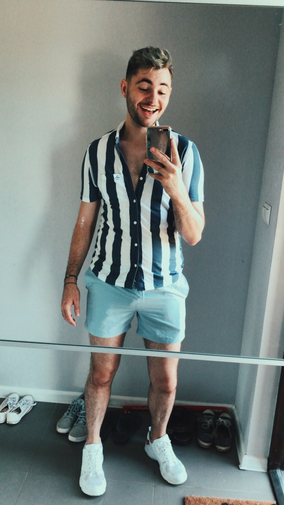 One of my favourite outfits from the trip. Blue and white stripey vertical short sleeved top, paired with light blue shorts and white trainers.