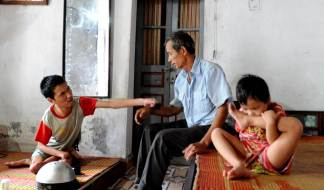 Grandfather Tran is taking care of his handcapped son Ha, 27 as well as his 6 year old granddaughter Lam. Lam is born without an anus and severely deformed. Neither Ha nor Lam can speak. A family with 2nd and 3rd generation victims of Agent Orange.
