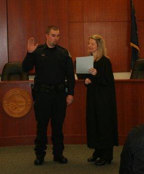 Reserve Officer Jordan Chase being sworn in