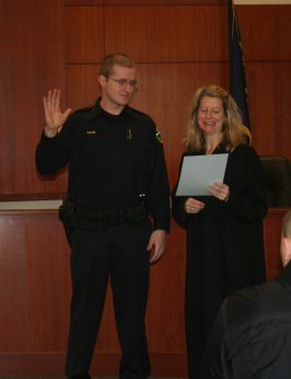 Reserve Officer Sam Tooze being sworn in