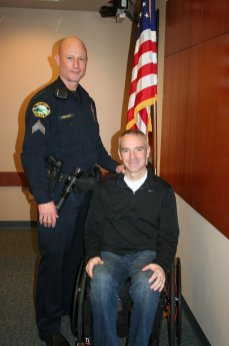 Sergeant Mike Stradley with Portland Police Officer Paul Meyer who pinned on Sgt. Stradley's badge.