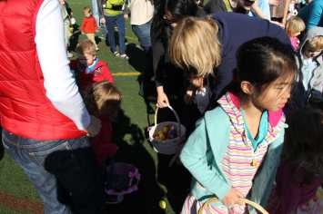 Children scramble to pickup as many eggs as possible