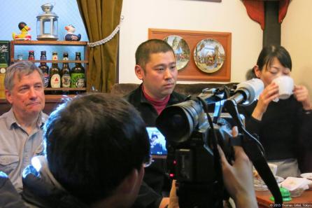 Takao Ochi speaks at the Feb. 8 event / Takao Ochi spricht auf der Veranstaltung