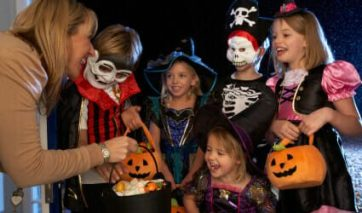 Children in costumes trick-or-treat on Halloween