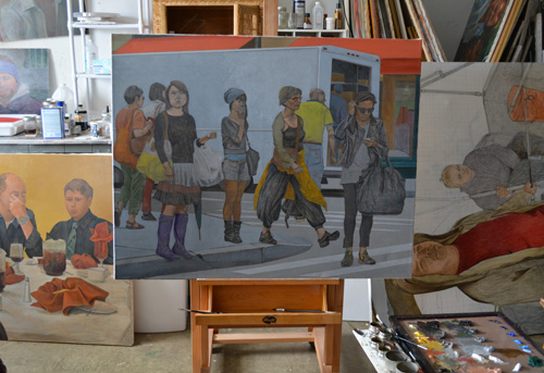 The unfinished painting titled 'Woman in Purple Boots' on the easel