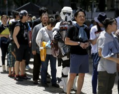 "A cosplayer dressed up as ""Star Wars"" character Scout Trooper joins a line to attend a Star Wars Day fan event in Tokyo"