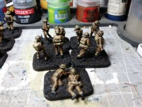 Followed by a dry-brush of khaki to lift the webbing and the packs