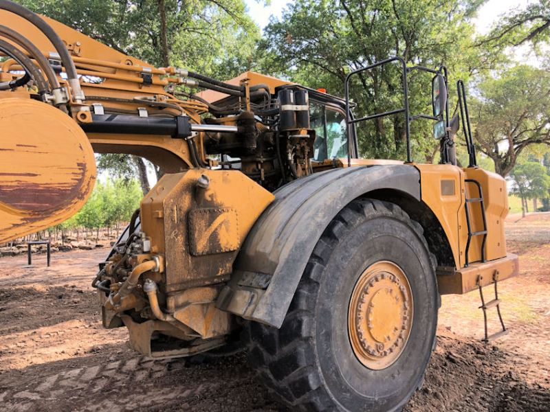 2012 Caterpillar 627H Right Front of cab from rear perspective