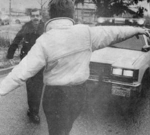 Argus Courier photo taken 12/15/1986 showing the author (Gerry) giving a DUI  suspect FSTs. That is actually me trying to keep my balance for the camera.