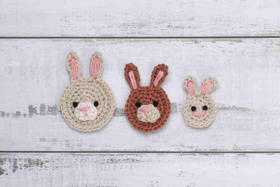 three crochetbunny appliques on a textured background.