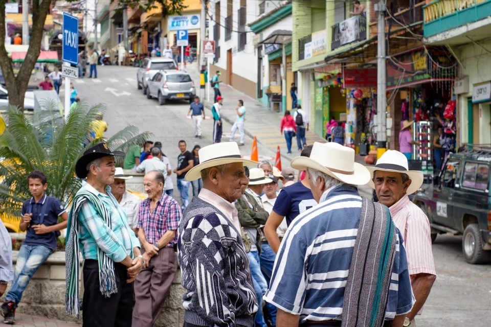 Colombian men in hats and ponchos