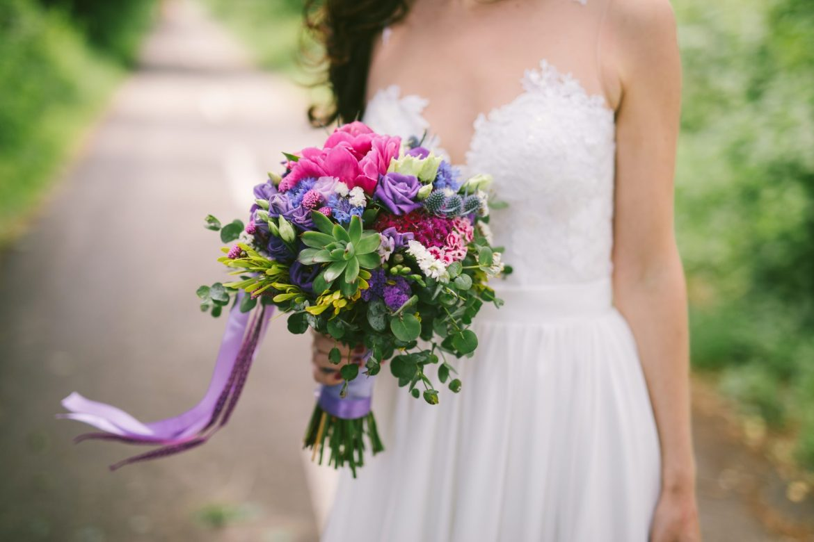 bride-with-colourful-violet-bouquet-In-her-hand