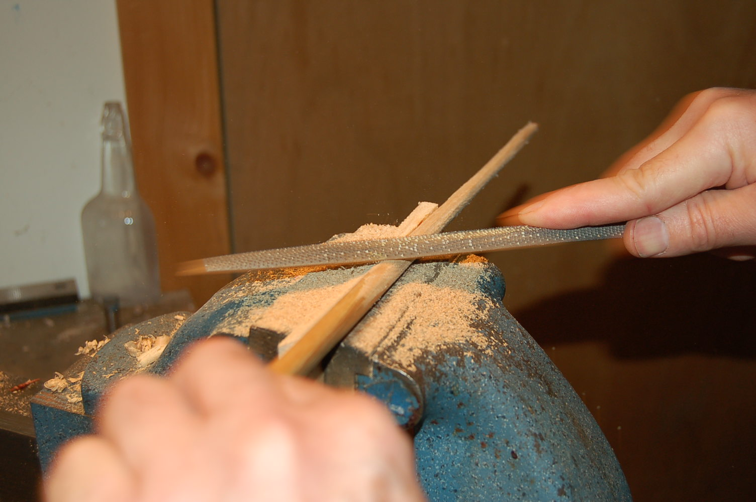 Rasping the taper on the rod