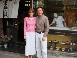 Tim and Christian Marcy, posing in front of one of a Japanese restaurant/snack shop.