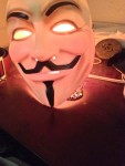 Brian Penny Versability Whistleblower Anonymous Red light Guy Fawkes Mask