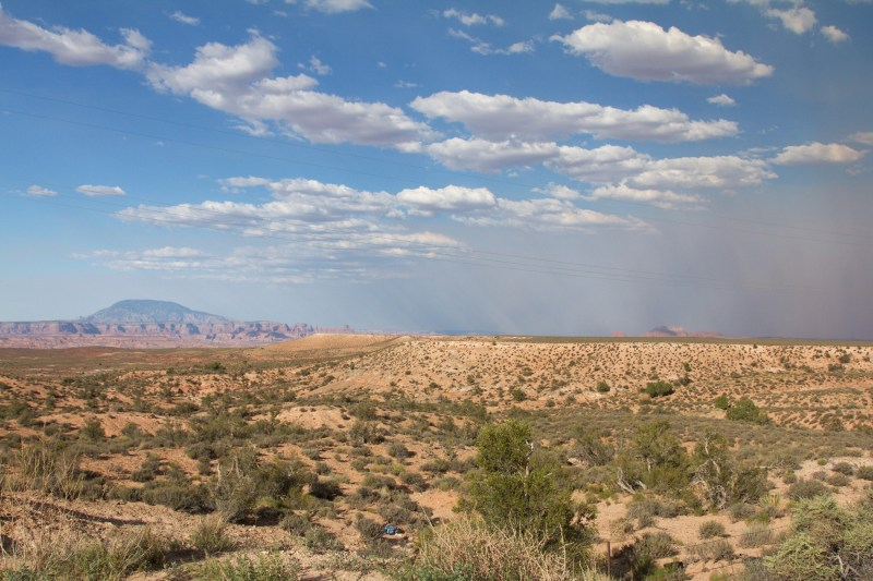 Desert driving. Smoke on the right from a big fire in the Grand Canyon