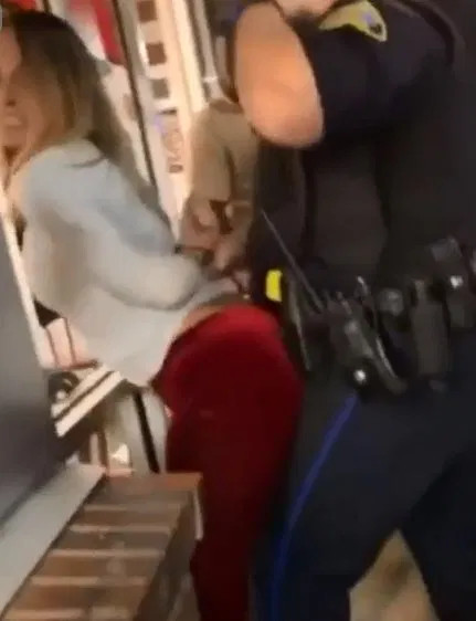 woman filmed grinding on police officer as he tries to arrest her