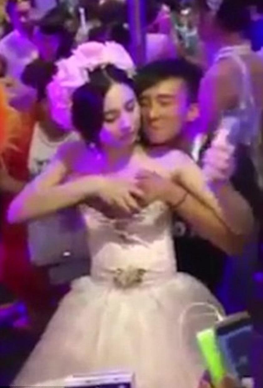 'bride' filmed letting men grope her breasts