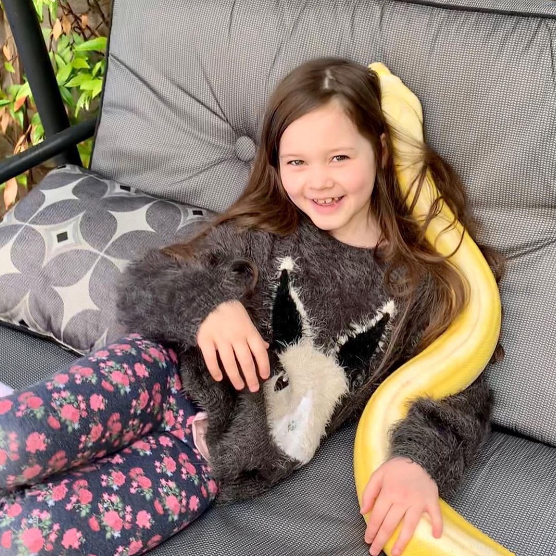 little girl is best friends with a huge python and the father couldn't be happier