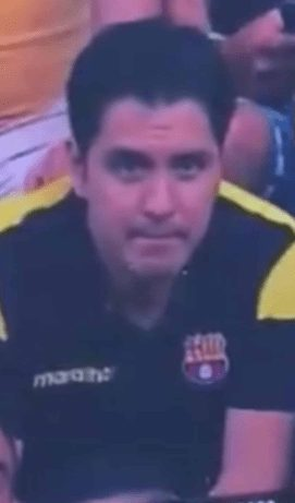 this guy's awkward reaction to being caught kissing on camera at a footie game is hilarious
