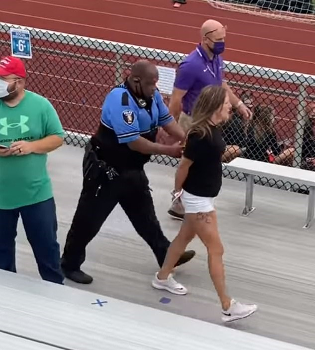 video: ohio mother arrested and tased for not wearing mask at son's middle school football game held outside