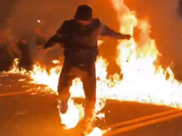 video: fayetteville, nc rioter accidentally lights self on fire