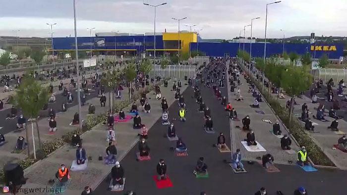 amazing photos show muslims using ikea parking lot for socially-distanced mass prayer
