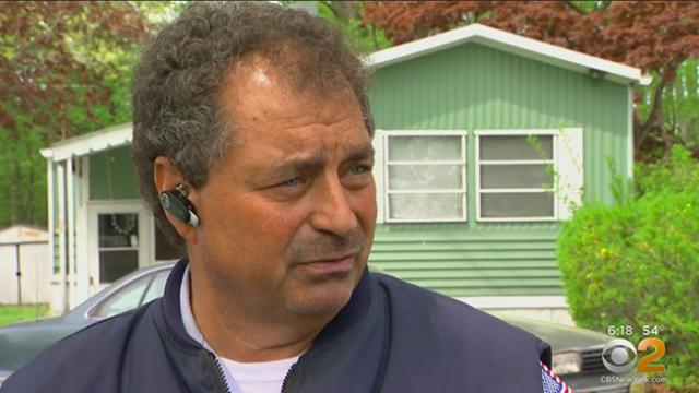 hero mailman sees infant alone in street, bursts through door to find mom hunched over stroller