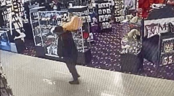 man casually steals three foot dildo from sex shop