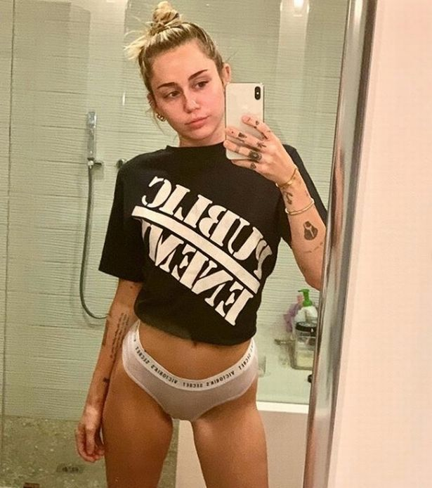 miley cyrus turns heads as she steps out in completely see-through tank top