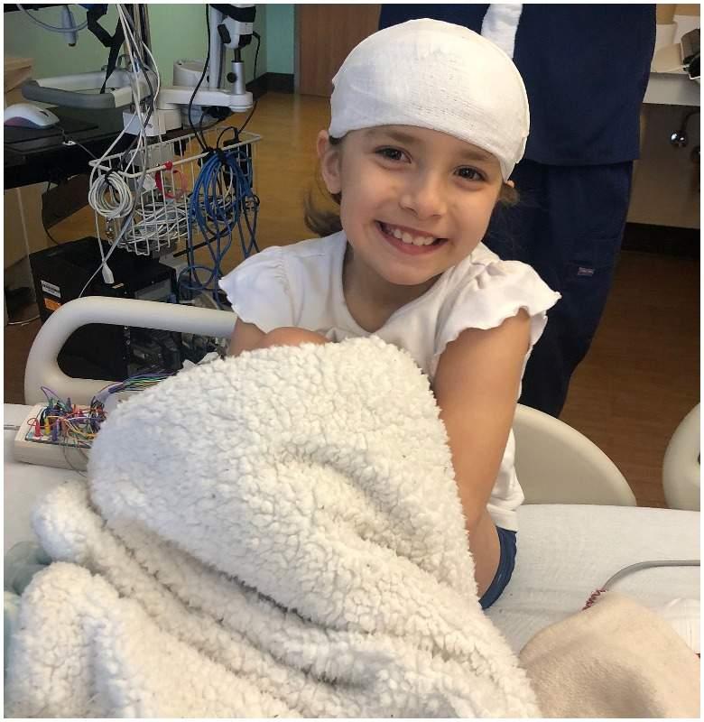 seven-year-old girl sells lemonade to help fund her brain surgeries