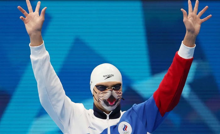 Olympian Insists To Wear His Favorite Cat Mask For The Medal Ceremony