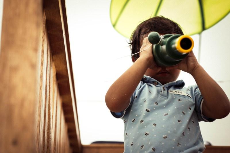 Toddler looking through periscope