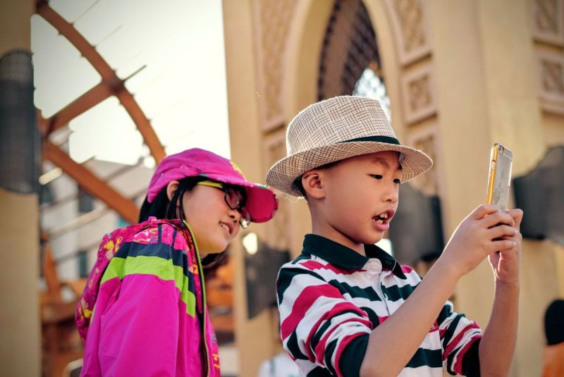 Kids using mobile phone