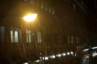 Rain in the light of a street lamp.