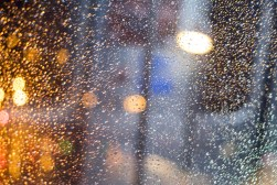 Drops on the window, the lights of The Loop.