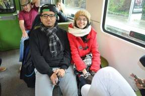 Two international students from Saudi Arabia in a Dublin, Ireland train