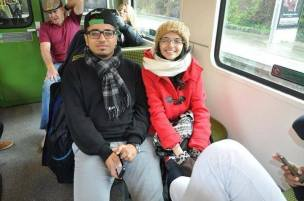 Two international students from Saudi Arabia in a Dublin, Ireland train